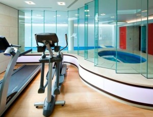 home-gym-with-a-spa-and-swimming-pool-glass